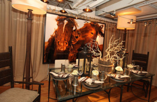 A sepia photograph of nuzzling horses hung behind the table designed by Richar Interiors Inc.