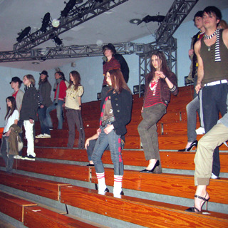 40ecfdf242ef Models struck disaffected poses on the gym s bleachers.